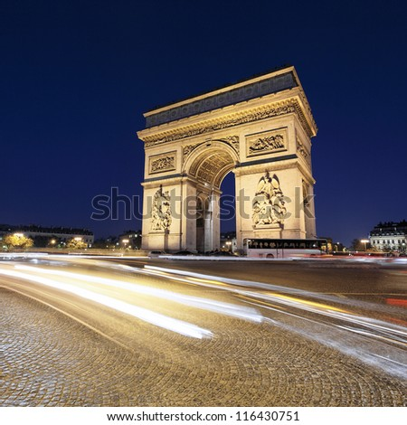 Arc de Triomphe by night with car lights, Paris, France - stock photo