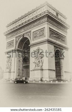 Arc de Triomphe de l'Etoile on Charles de Gaulle Place, Paris, France. Arc is one of the most famous monuments in Paris. Antique vintage. - stock photo
