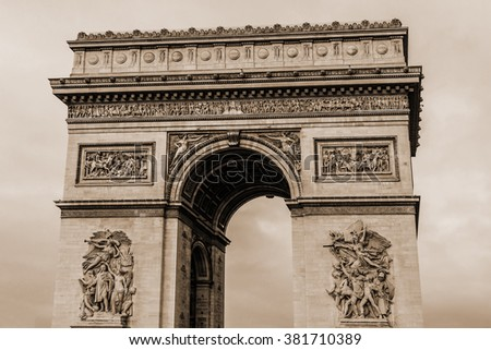 Arc de Triomphe de l'Etoile on Charles de Gaulle Place, Paris, France. Arc is one of the most famous monuments in Paris. Vintage, sepia.