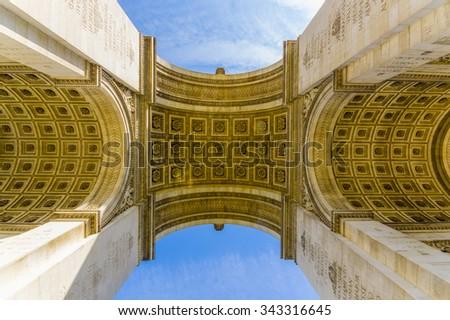Arc de Triomphe de l'Etoile, Triumphal Arc of the Star, Paris, France. Low angle shot - stock photo