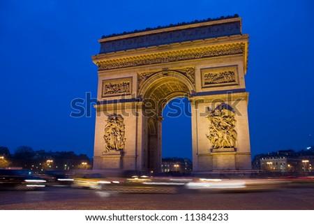 Arc De Triomphe in Paris France at night - stock photo