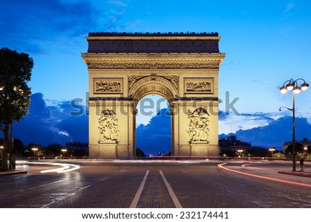 Arc de Triomphe in Paris in the evening, view from Chaps Elysees, France - stock photo