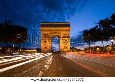 Arc de Triomphe of Paris, seen from Champs Elysees - stock photo