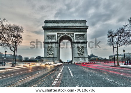 Arc de triomphe on the Charles de Gaulle square in Paris, France - stock photo