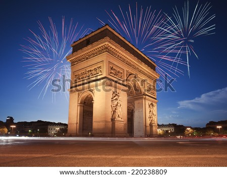 Arc de Triomphe, Paris lit up by Fireworks - stock photo