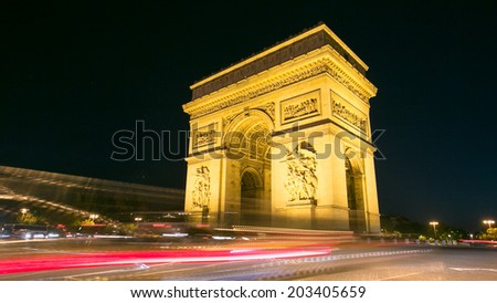 Arc of Triomphe Champs Elysees Paris city at night - stock photo