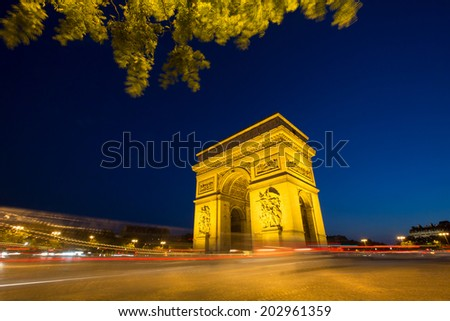 Arc of Triomphe Champs Elysees Paris city at sunset - stock photo