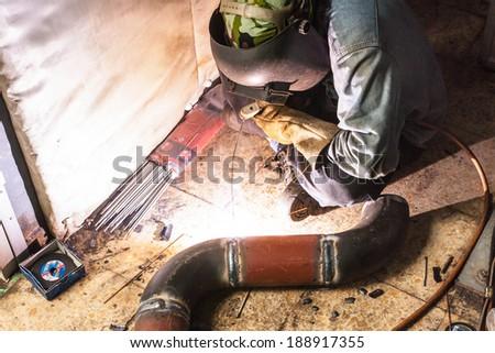 Arc welder at work. - stock photo