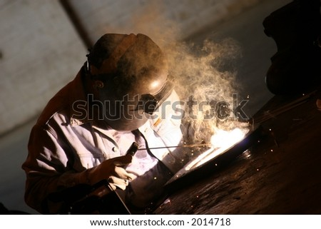 Arc welder at work at his workbench