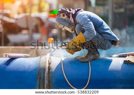 Arc welder with welding sparks, outside