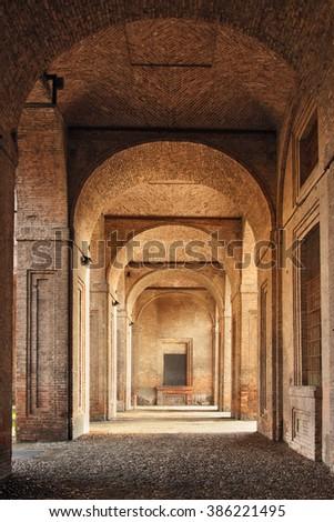 Arcade in medieval building, Palazzo Della Pilotta in Parma, Italy. - stock photo