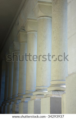 Arcade of white cylindrical columns supporting roof
