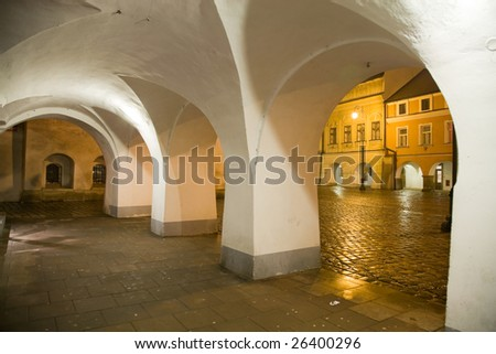 Arcade with town square in Litomysl at night lighting. UNESCO heritage.