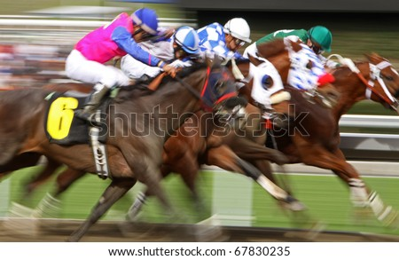 ARCADIA, CA - DEC 26: A field of thoroughbreds storm down the homestretch in the first race of the season at Santa Anita Park on Dec 26, 2010 in Arcadia, CA. - stock photo