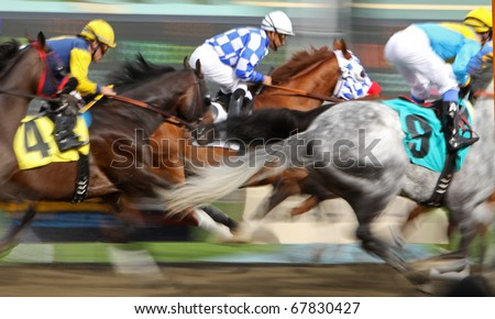 ARCADIA, CA - DEC 26: Skellytown (blue checks), under Victor Espinoza, surges up the inside to win the first race of the 74th Santa Anita Park meet on Dec 26, 2010 in Arcadia, CA. - stock photo