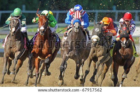 ARCADIA, CA - DEC 27: Two-year-old Uncle Sam (red & white stripes), under Rafael Bejarano, breaks his maiden at Santa Anita Park on Dec 27, 2010 in Arcadia, CA. - stock photo