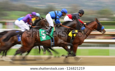 "ARCADIA, CA - FEB 2: Hall of Fame Jockey Gary Stevens (black cap) pilots ""Ti the Truth"" to his first win at Santa Anita Park on Feb 2, 2013 in Arcadia, CA. - stock photo"