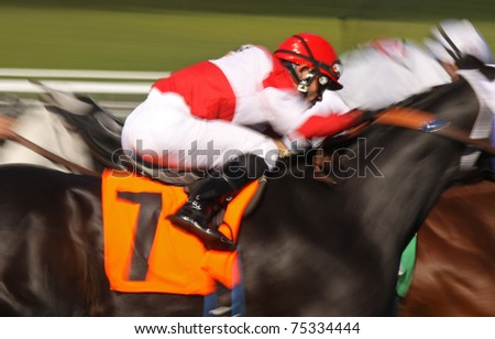 ARCADIA, CA - FEB 10, 2010: Jockey Joel Rosario competes in a thoroughbred race at historic Santa Anita Park on Feb 10, 2010 in Arcadia, CA.