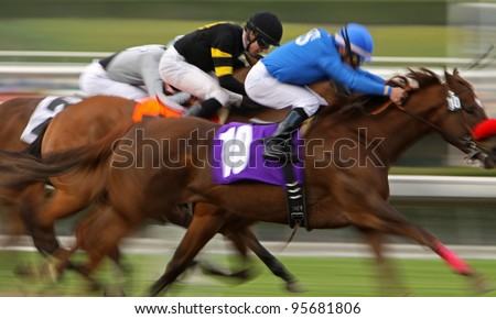 ARCADIA, CA - FEB 19: Jockeys struggle for the lead in a maiden race at Santa Anita Park in Arcadia, CA, on Feb 19, 2012.