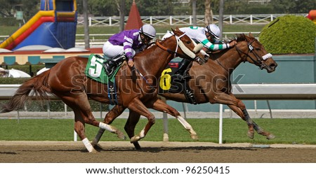 """ARCADIA, CA - FEB 25: Martin Pedroza and """"Big Tsimmis"""" outrun Edwin Maldonado and """"After Later"""" to place 2nd in the 1st race  at Santa Anita Park in Arcadia, CA, on Feb 25, 2012. - stock photo"""