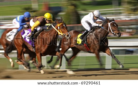 ARCADIA, CA - JAN. 15: Female jockeys Joy Scott (white cap) and Nicole Shinton (gold cap) battle for the lead in a claiming race at Santa Anita Park on Jan. 15, 2011 in Arcadia, CA. - stock photo