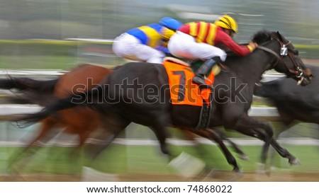 "ARCADIA, CA - MAR 12:  Jockey Garrett Gomez (gold cap) races ""Temptation Bound"" to a 3rd place finish in a maiden race  at Santa Anita Park on Mar 12, 2011 in Arcadia, CA. - stock photo"
