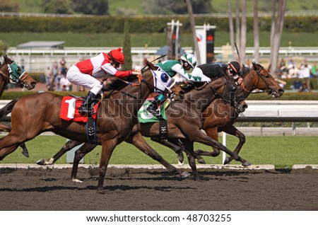 "ARCADIA, CA - MAR 13: Jockey Michael James (on the rail) hangs on to his lead, piloting ""Malibu Artiste"" to a win in race 2 at Santa Anita Park on Mar 13, 2010 in Arcadia, CA."