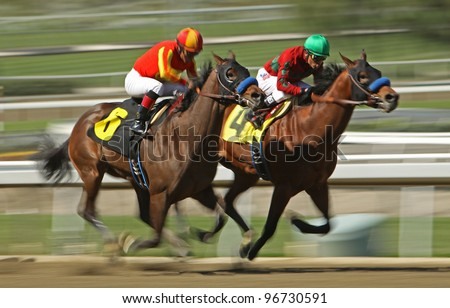 "ARCADIA, CA - MARCH 3: Jockey Martin Garcia and ""Mile High Magic"" (#6) move up on Rafael Bejarano and ""Eaton Hall"" to win a maiden race at Santa Anita Race Track on March 3, 2012 in Arcadia, CA. - stock photo"