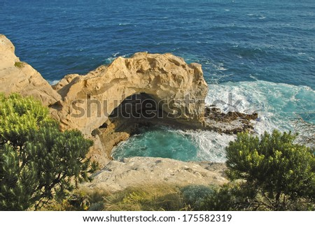 Arch Along Rugged Coast of Port Campbell in Victoria, Australia - stock photo