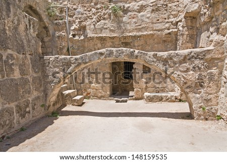 Arch before building entrance in Pool of Bethesda ruins. Old City of Jerusalem, Israel.