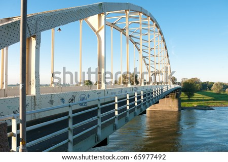 arch bridge over the river Ijssel, Netherlands - stock photo