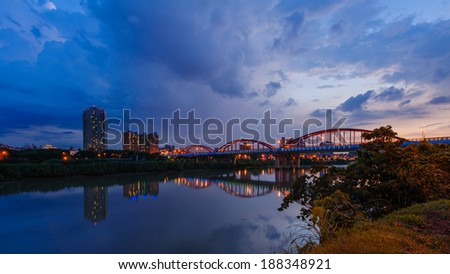 arch bridge over the river in Taipei by the sunset - stock photo