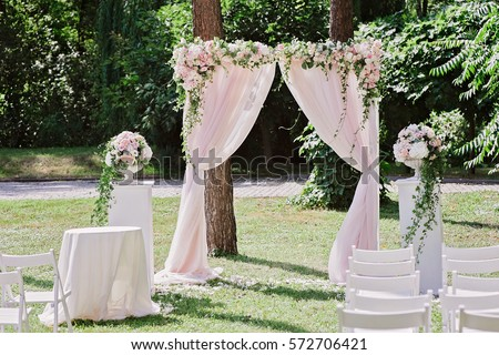 Arch wedding ceremony decorated cloth flowers stock photo 572706421 arch for the wedding ceremony decorated with cloth and flowers junglespirit Image collections