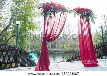 Arch wedding ceremony decorated cloth flowers stock photo image arch for the wedding ceremony decorated with cloth flowers and greenery is in a junglespirit Gallery
