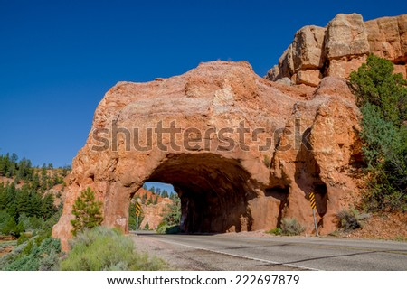 arch formation tunnel in road bryce canyon national park utah - stock photo