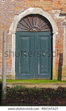 Arch Green Door at Canal House in Venice