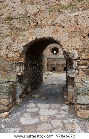 arch in old fortress - stock photo