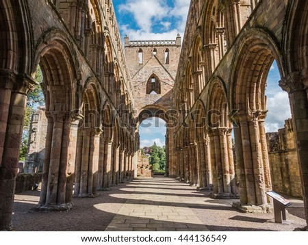 Arch in th ruins of Jedburgh Abbey in the Scottish Borders region in Scotland