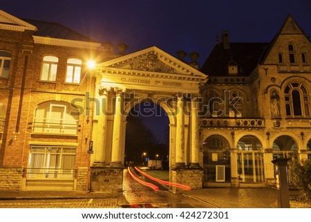 Arch in Ypres at night. Ypres, West Flanders, Flemish Region, Belgium