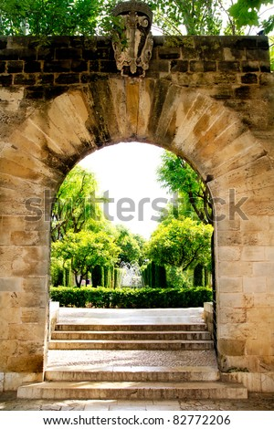 Arch of stone in entrance to Hort del Rei gardens Palma de Mallorca near Almudaina - stock photo