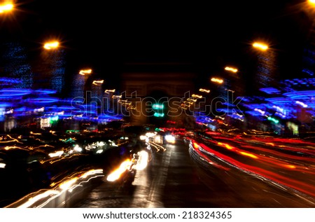 Arch of Triumph and Champs Elysees with Christmas festive illumination. Paris in winter. Blurred cars in motion. - stock photo
