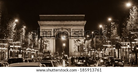 Arch of Triumph and Champs Elysees with Christmas festive illumination. Paris in winter. Sepia. - stock photo