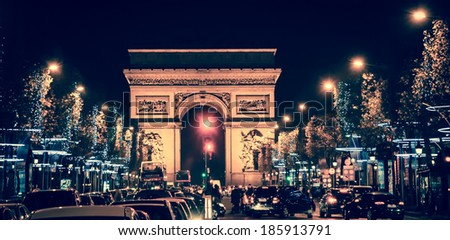 Arch of Triumph and Champs Elysees with Christmas festive illumination. Paris in winter. Toned image. - stock photo
