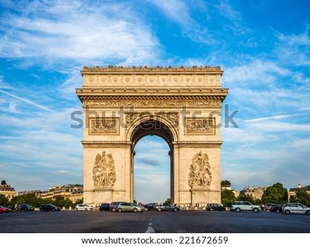 Arch of Triumph (Arc de Triomphe) with dramatic sky, Paris, France - stock photo