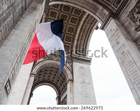 Arch of Triumph detail with national flag in Paris, France. - stock photo