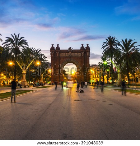Arch of Triumph in Barcelona, Spain at night. Sunset, motion blurred people, lights and illumination - stock photo