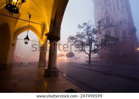 Arch on the market square in Krakow at morning fog, Poland - stock photo