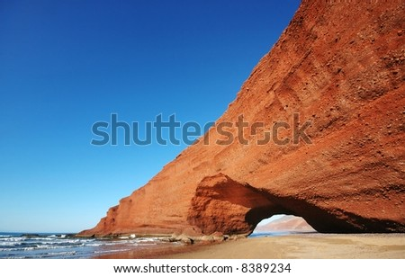 Arch rock formation on the beach. Morocco. - stock photo
