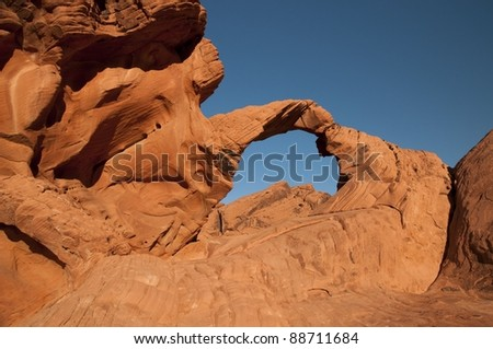 Arch rock in Nevada's Valley of Fire - stock photo