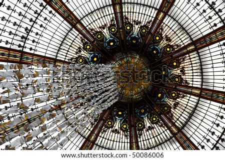 Arch roof of the dome in Galeries Lafeyette in Paris, capital of France, Europe - stock photo